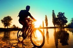 silhouette of a cyclist near the river Irpen, Kiev, Ukraine