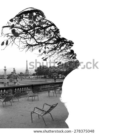 Silhouette of a female head (profile), framing fragment of Paris panorama with the Eiffel Tower in the background, double exposure. Black and white photo, bright background