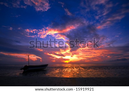 SIlhouette of a fishing boat on one of the beaches in Pahang, Malaysia.