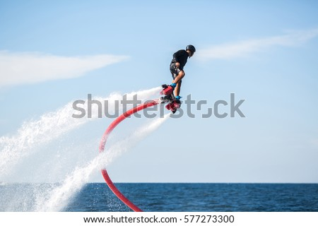 Silhouette of a fly board rider at sea #577273300