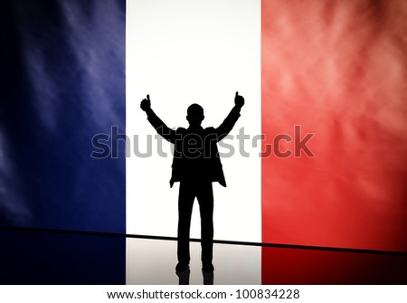 Silhouette of a french politician with thumbs up against flag background