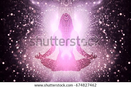 Silhouette of a girl in Lotus position on the background of the universe. A state of trance and deep meditation. A spiritual journey in the universe.