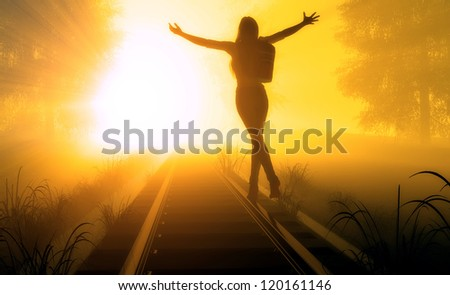 Silhouette of a girl on the railway in the light. - stock photo