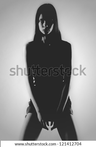 Silhouette of a girl sitting on a white background.