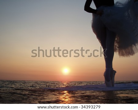 Silhouette of a girl standing in ballet pose