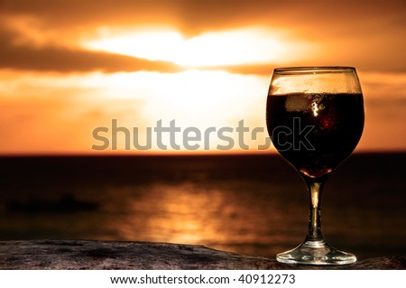 Silhouette of a Glass of wine on the see shore in a lovely evening