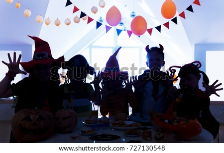 Silhouette of a group of children on the holiday Halloween