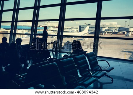 silhouette of a group of people in an airport waiting hall. travel business concept #408094342
