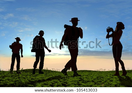 Silhouette of a group of people on the grass.
