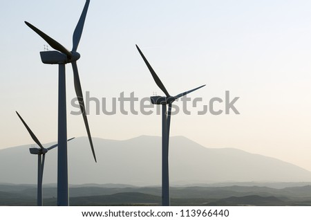 silhouette of a group of windmills for renewable electric energy production, Fuendejalon, Zaragoza, Aragon, Spain