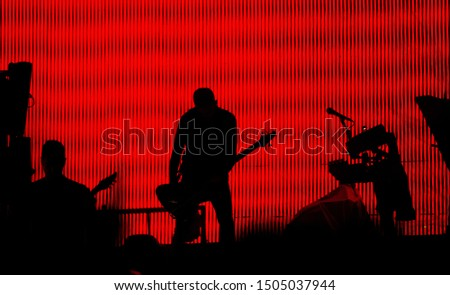 silhouette of a guitarist on stage during concert