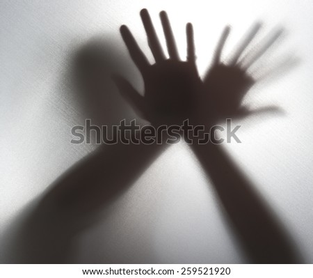 Silhouette of a hand in the back light,blur image