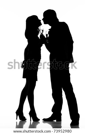 Silhouette of a happy couple with wine glasses as logo. Isolated on white