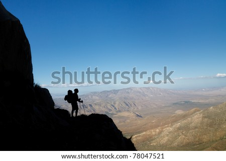 Silhouette of a hiker viewing Anza-Borrego Desert State Park, Southern California, USA