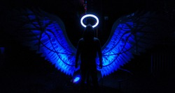Silhouette of a hooded guy with Blue Angel Wings and nimbus