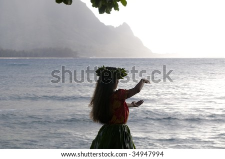 silhouette of a hula dancer dancing on the beach in Kauai at sunset