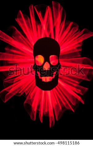 Silhouette of a Human Skull backlit… Stock Photo 498115222
