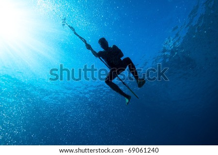 Silhouette of a indonesian hunter in blue sea #69061240