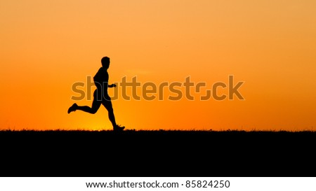 silhouette of a jogger in sunrise