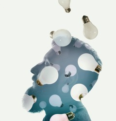 Silhouette of a male head with falling light bulbs. The concept of new ideas, creativity, revolutionary discoveries.
