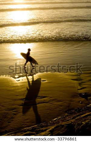 silhouette of a male surfer at sunrise on the gold coast