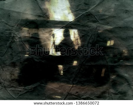 Silhouette of a man against a big fire. Fire caster, expeller. Hell of a scene, devil's chariot. Fantasy. Imitation of an ancient treatise on parchment paper