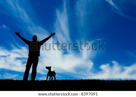 Silhouette of a man and his dog.
