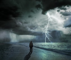 silhouette of a man and stormy sea, concept of uncertainty and obscurity of future
