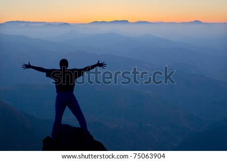 Silhouette of a man and the mountains of Euskadi in the background