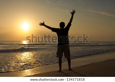 silhouette of a man at sunrise on the sea