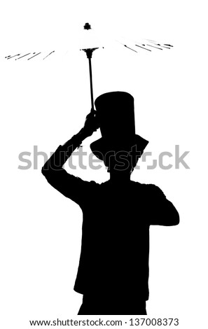 Silhouette of a man in a hat with an umbrella.