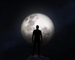 Silhouette of a man on background of the Moon. Elements of this image furnished by NASA.