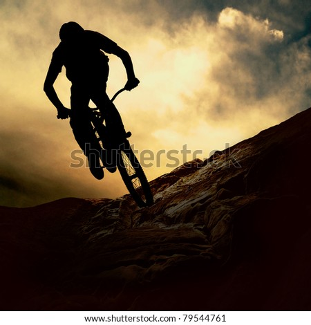 Silhouette of a man on muontain-bike, sunset #79544761