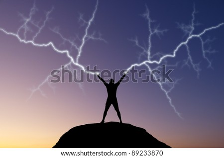 silhouette of a man on the hill out of the hand produces lightning. natural composition