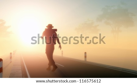 Silhouette of a man on the road. - stock photo