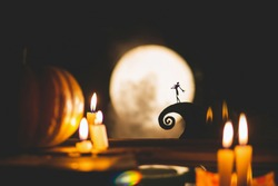 Silhouette of a man or a poet on the background of the moon and pumpkins. Feast of the day of the dead or Halloween. Small world and ciliate