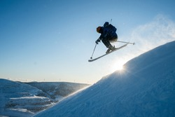 Silhouette of a man skiing in the Chic Chocs in Quebec Canada