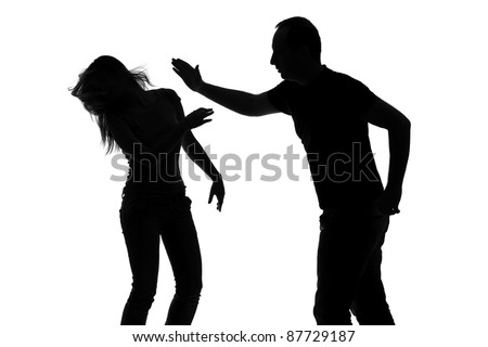 Silhouette of a man slapping a woman depicting domestic violence isolated against white background
