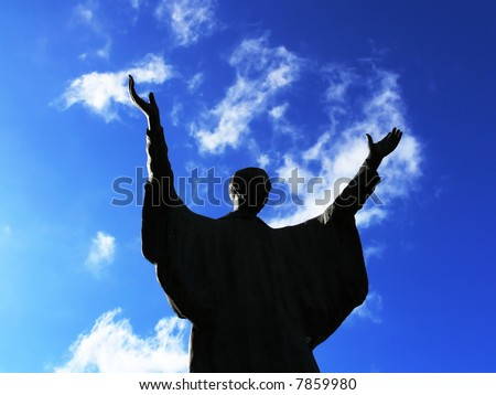 Silhouette of a man that praying with the arms direct to the sky