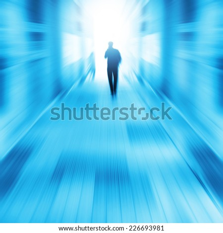 Silhouette of a man walking in a tunnel to light. #226693981