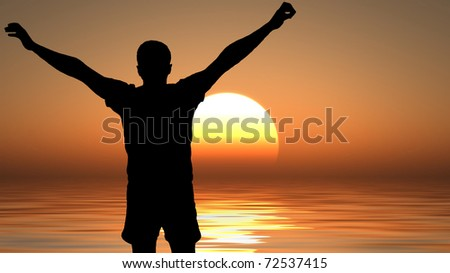 silhouette of a man with his arms raised at sunset