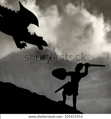 Silhouette of a medieval knight fighting the dragon