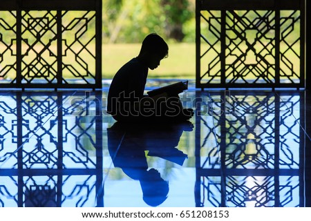 silhouette of a muslim kids reciting Al-quran at mosque. #651208153
