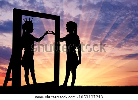 Silhouette of a narcissistic woman with a crown on her head and a hand gesture of the heart in reflection in the mirror. The concept of narcissism and selfishness