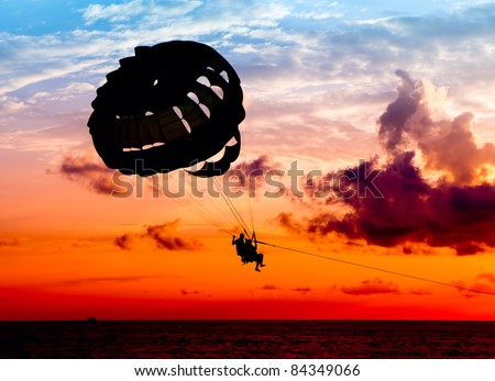 Silhouette of a para-sailor at sunset