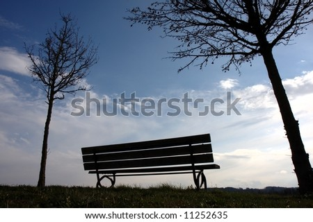 silhouette of a park bench