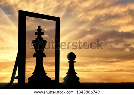 Silhouette of a pawn, sees himself in the reflection of the mirror queen. The concept of narcissism and ego ストックフォト ©