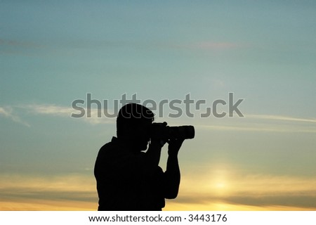 Silhouette of a photographer during the sunset