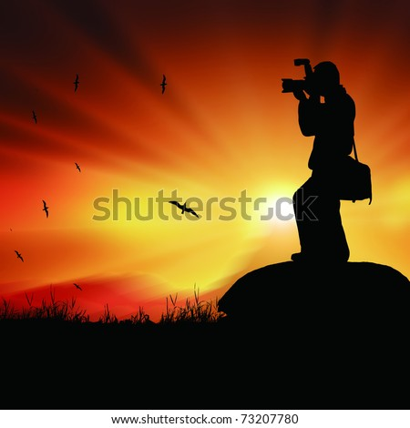 Silhouette of a photographer with a camera