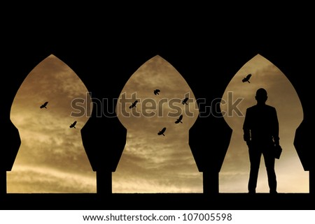 Silhouette of a preacher man standing between a Moorish architectural archway during a surreal sunset with flock of birds flying into the horizon.